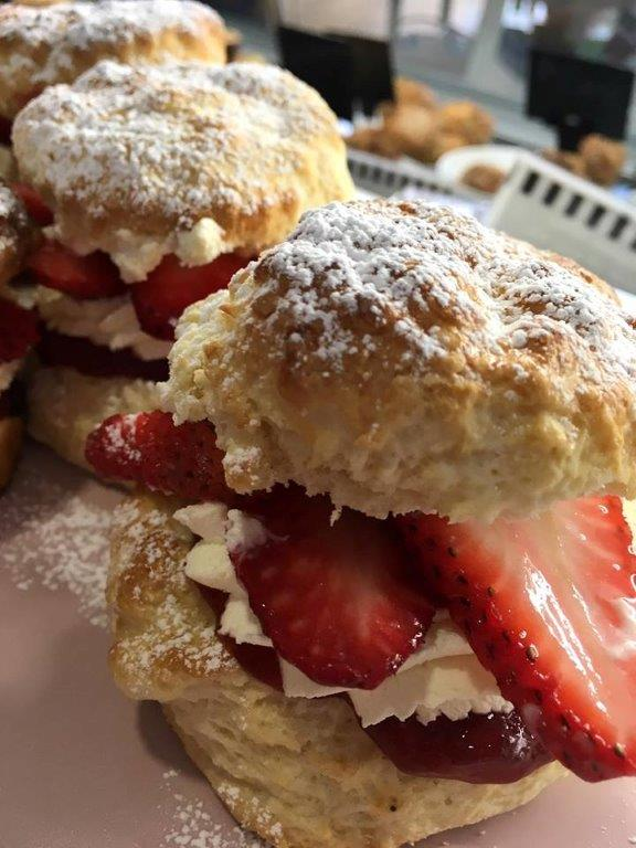 Scones filled with strawberries and cream