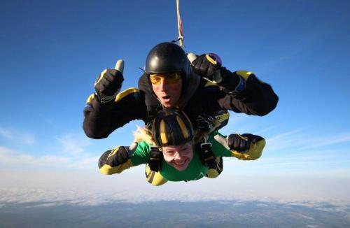 Two people skydiving together